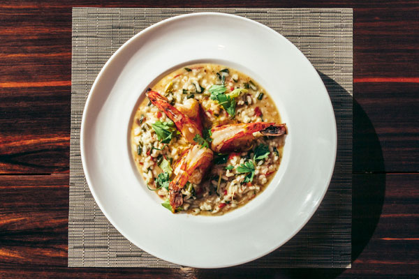 Soupy risotto, the grains perfectly distinct, sweetened with sun-dried tomatoes and crowned by fat grilled shrimp