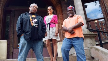 Raymond Thomas, Heather Robinson, and Dayo Laoye on the steps of the South Side Community Art Center