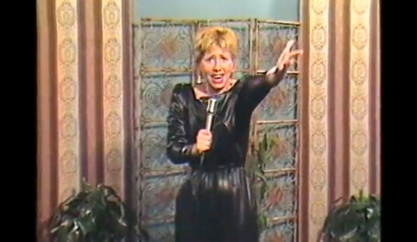 "Lucille Cataldo performing her song ""Hairdresser"" on <em>Stairway to Stardom</em>"