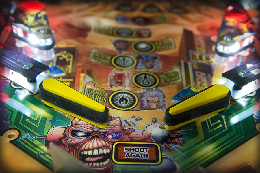 A close look at the flippers of the Iron Maiden game before the playfield glass is installed