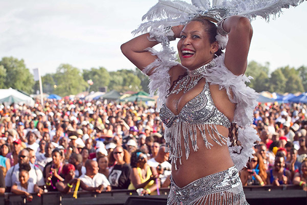 A dancer hypes the crowd at the 2012 picnic.