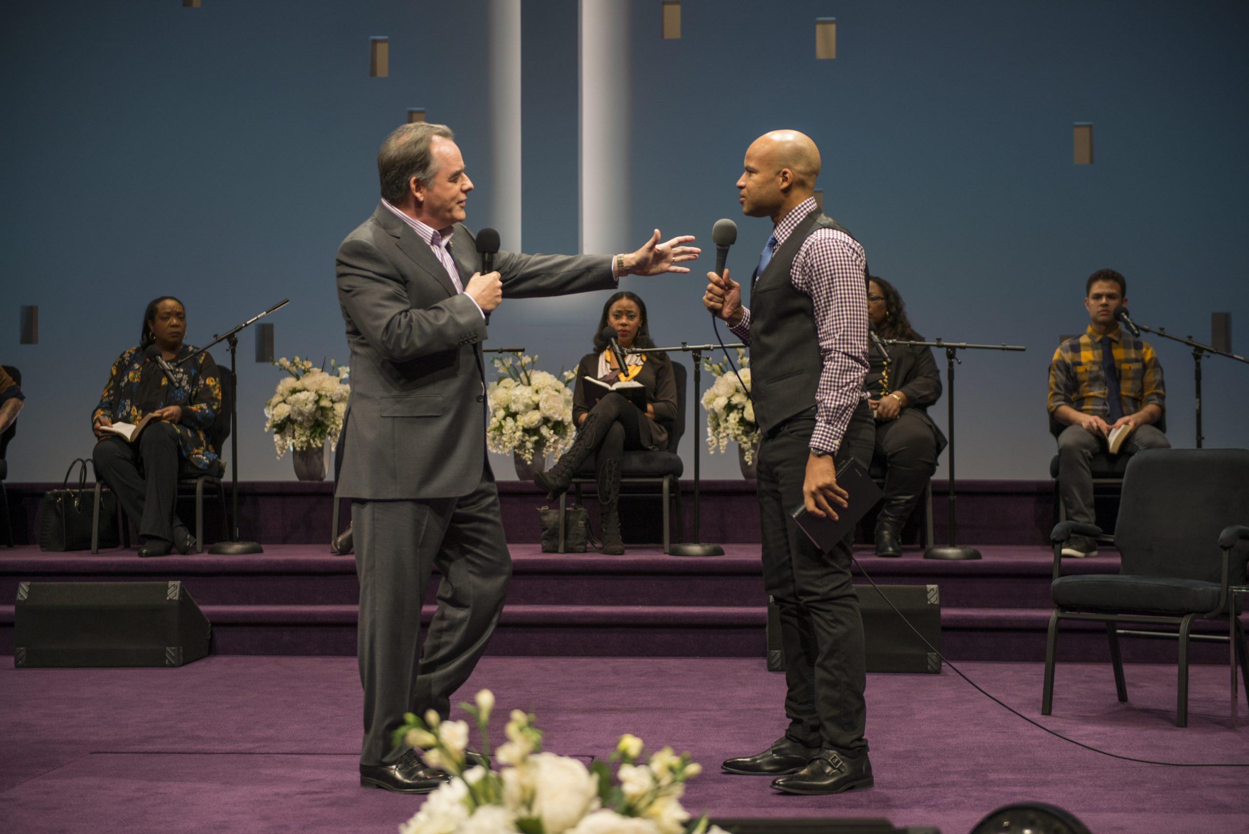 Pastor Paul (Tom Irwin) has a theological debate with an associate pastor (Glenn Davis) in <i>The Christians</i>.