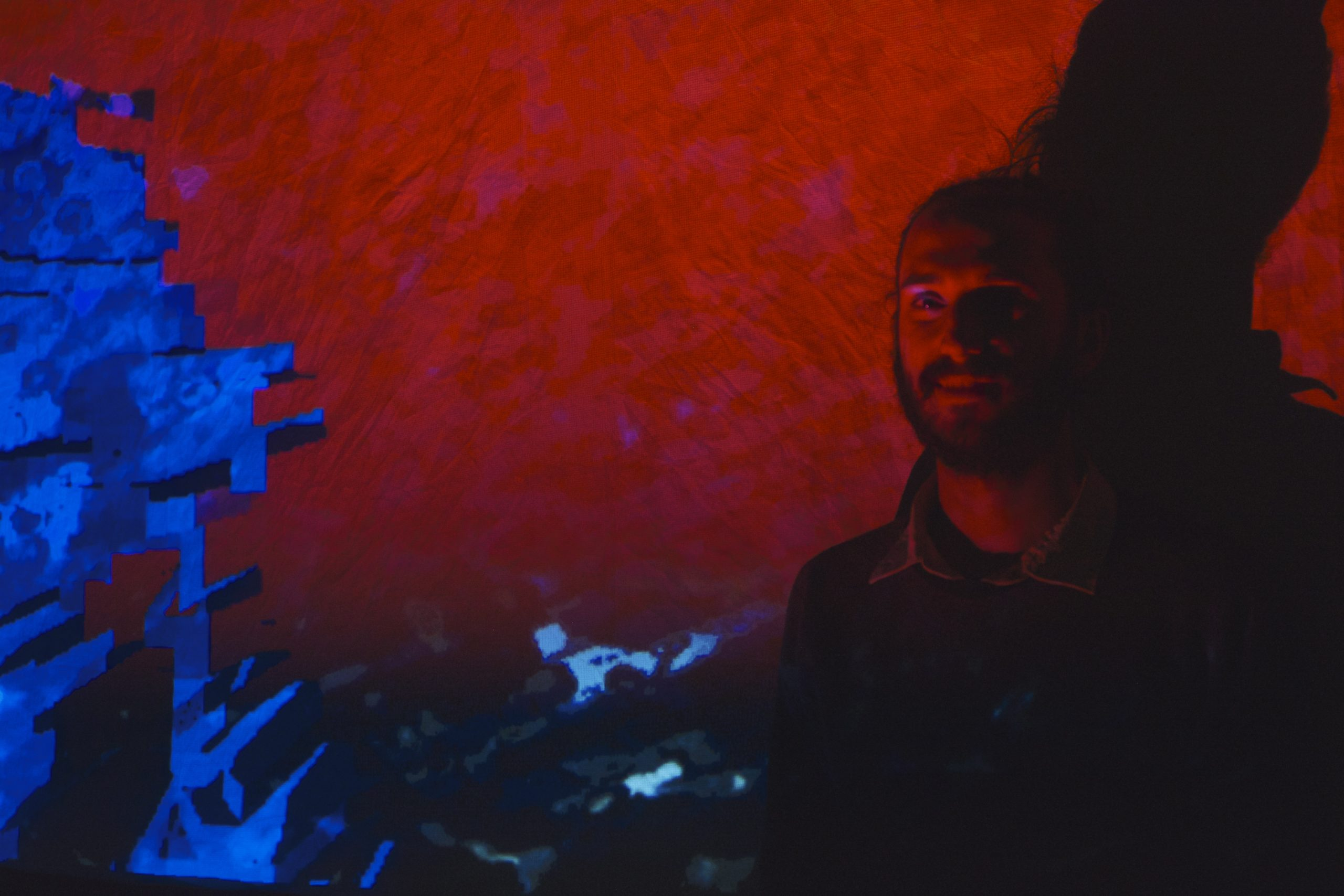 Alex Palma and a portion of his video installation
