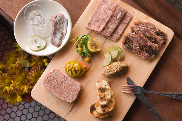 Maatjesharing shot and charcuterie plate at Vincent