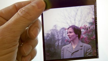 Photographer and Northwestern senior lecturer Pamela Bannos holds a transparency of Vivian Maier from the collection of Ron Slattery.