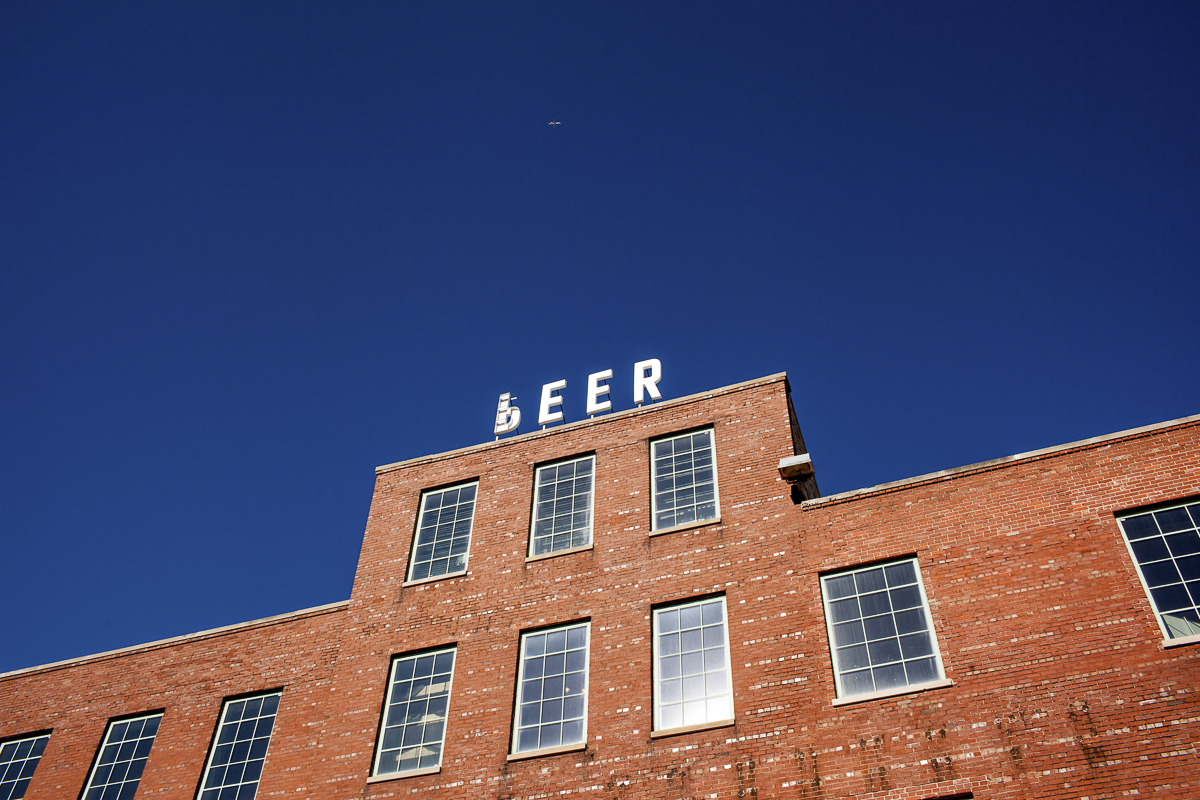 """The <i>P</i> on the Peer sign atop the former Peer Foods meatpacking plant in Back of the Yards has been flipped to spell """"beer."""""""