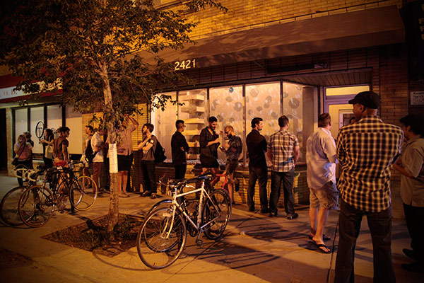Hipsters waiting patiently to get inside the Whistler in Logan Square