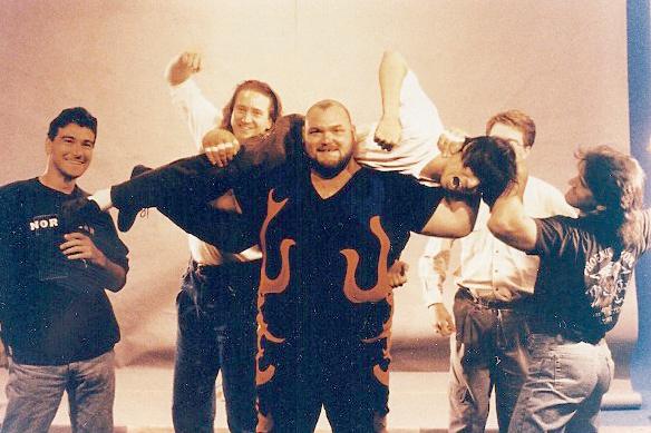 Tsui hoisted by pro wrestler Bam Bam Bigelow