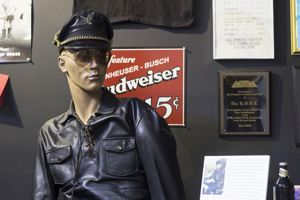"""The Leather Archives & Museum's bar exhibit """"regular,"""" Randy, watches over a collection of nightlife artifacts."""