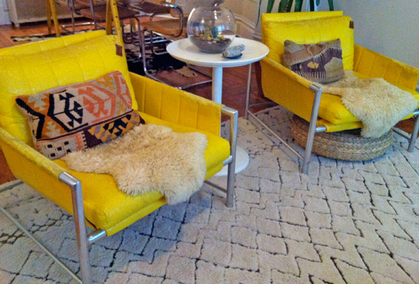 The yellow vinyl is peeled and the cushions are worn. My dog Bunny even prefers the rug over curling up in these chairs!