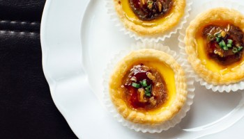 Flaky cups of pastry cradling warm sweet custard, capped with liquefied foie gras