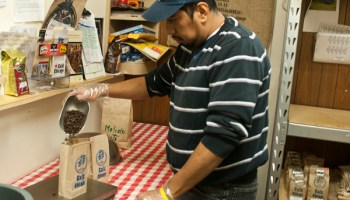 Alejandro Serrano packages coffee for Cafe Chicago at the Albany Park Workers' Center.
