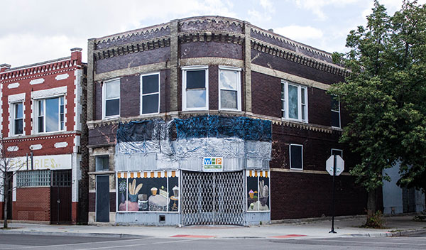 The Neighborhood Foundation suggests the possibilities of the vacant corner storefront at 3525 W. Chicago with a bakery-themed decorative board-up.