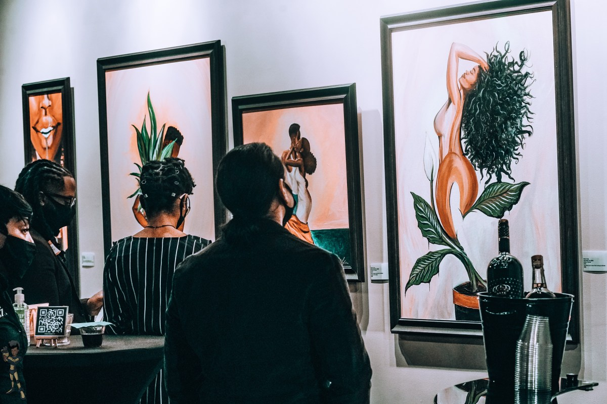 Viewers take in paintings at Art West in Lawndale
