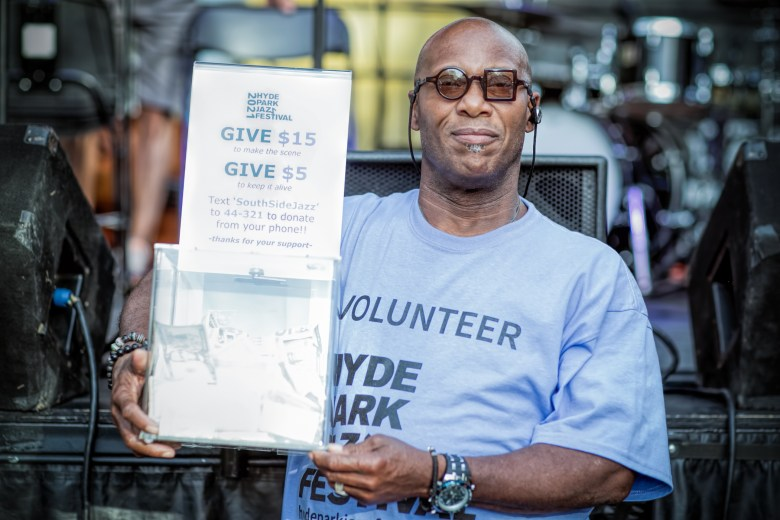 Festival volunteer Carl Denoms solicits donations at the Hyde Park Jazz Festival.
