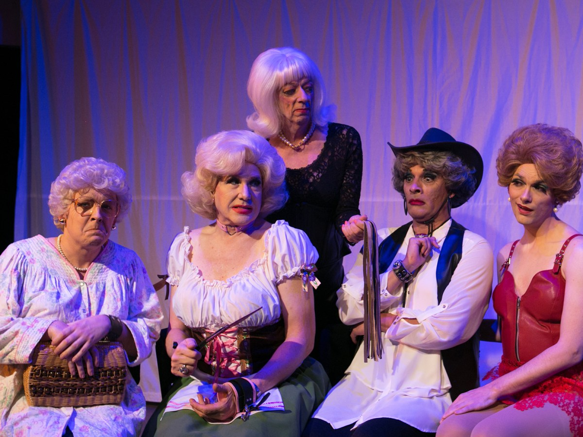 Five actors in drag as the Golden Girls. One holds a flogger.