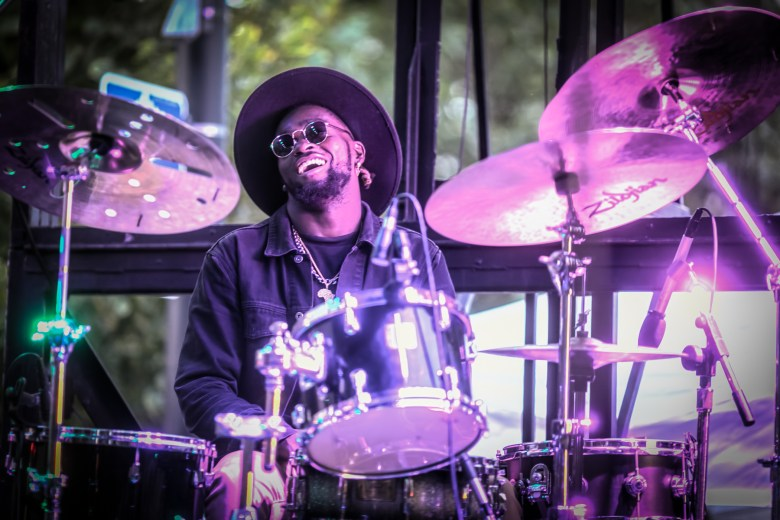 Drummer Jeremiah Collier plays in Isaiah Collier's band the 3-6 Project at the Hyde Park Jazz Festival.