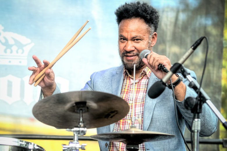 Drummer Mike Reed takes the microphone from behind the drums with his band People, Places & Things.