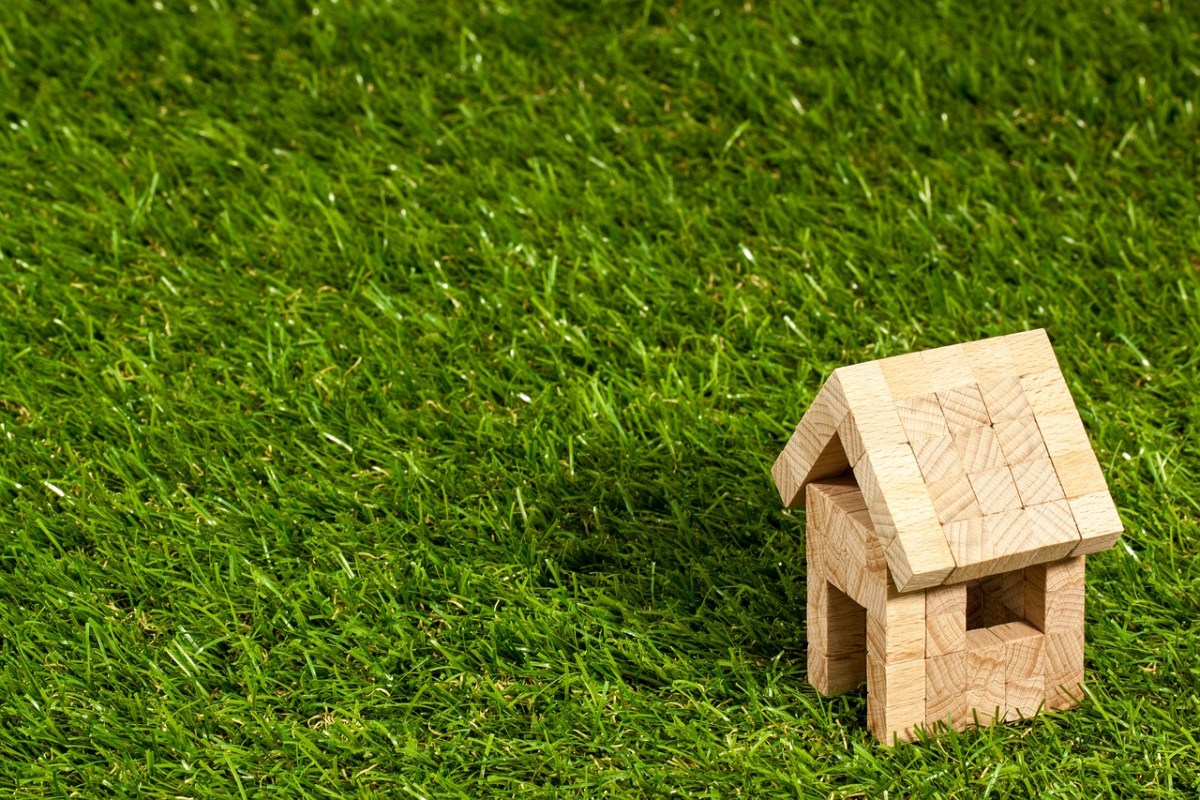 A small wooden house sitting on grass