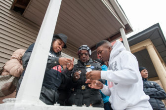 Janet Cooksey (left), lights a candle for her son, Quintonio LeGrier, and neighbor Bettie Jones who were shot and killed by Chicago Police on Dec. 26, 2015. A few days after the fatal shootings, Mayor Rahm Emanuel announced changes at the Police Department, including the purchase of additional Tasers and training officers to use weapons other than guns.