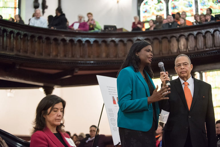 State's Attorney candidate Kim Foxx answers questions at the Faith in Action Assembly on Martin Luther King Day, while Anita Alvarez looks on.
