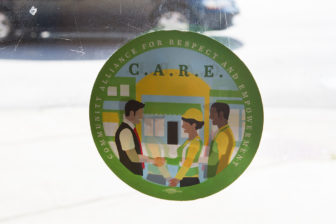 To encourage residents to patronize businesses that treat workers fairly, companies who sign the Community Alliance for Respect and Empowerment (C.A.R.E.) agreement receive a placard to display in storefront windows.