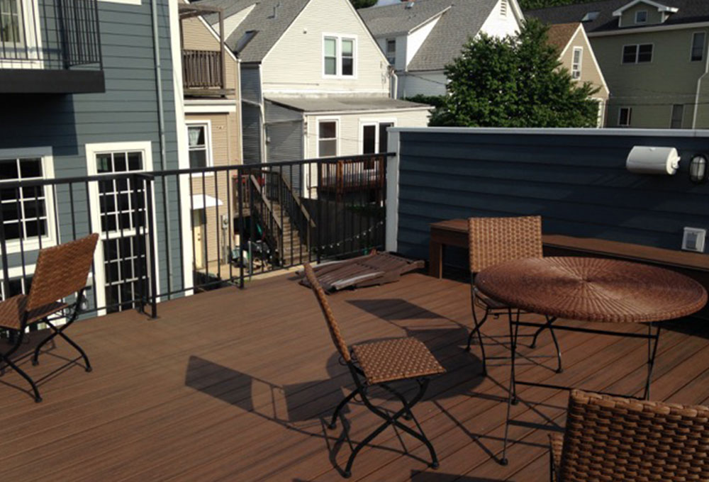built in kitchen seating wooden play set clean and simple garage roof deck - chicago + garden