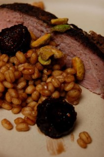 Nick and Shannon's SousVide aged beef topped with pressure cooked barley, pistachio, and pickled figs