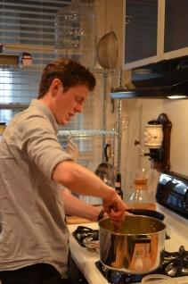 Justin stirring his pork vindaloo