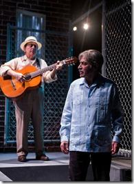 Musician Nelson González and Jaime Tirelli (Agustín) in Quiara Alegría Hudes' The Happiest Song Plays Last, directed by Edward Torres at Goodman Theatre. (photo credit: Liz Lauren)