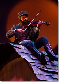 "Ryan Naimy as the Fiddler in Light Opera Works' ""Fiddler on the Roof"" by Jerry Bock, Sheldon Harnick and Joseph Stein, directed and choreographed by Rudy Hogenmiller. (photo credit: Mona Luan)"