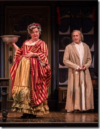 """Kim Schultz and Larry Yando in Goodman Theatre's """"A Christmas Carol"""" by Charles Dickens, adapted by Tom Creamer, directed by Henry Wishcamper. (photo credit: Liz Lauren)"""