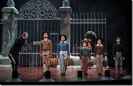 """Larry Neumann Jr., Phillip Cusic, Skye Sparks, Nathaniel Buescher, Amaris Sanchez and Aaron Lamm in Goodman Theatre's """"A Christmas Carol"""" by Charles Dickens, adapted by Tom Creamer, directed by Henry Wishcamper. (photo credit: Liz Lauren)"""