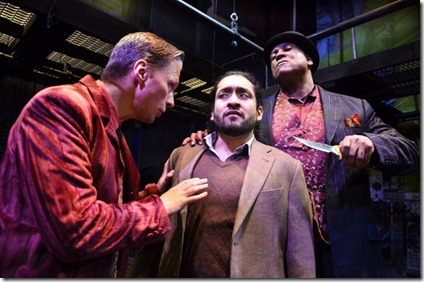 John Henry Roberts as Mr. Croup, Jose Nateras as Richard Mayhew, and LaQuin Groves as Mr. Vandemar in Neverwhere