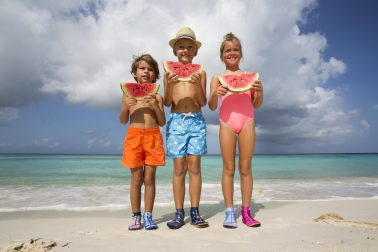 Kids happy with watermelons