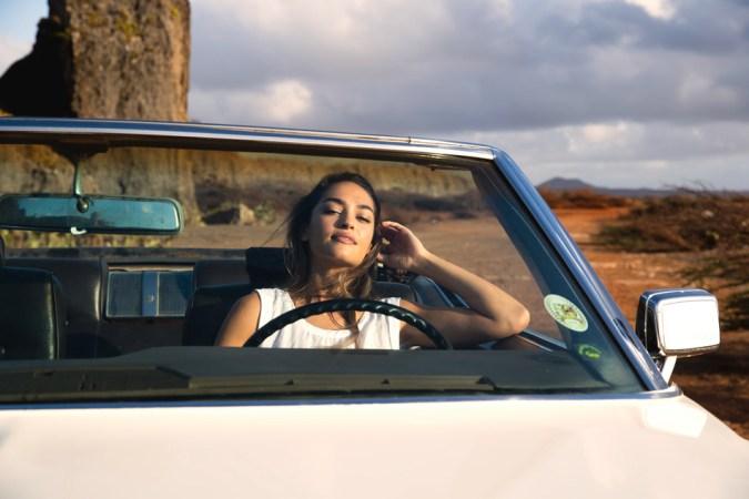 Model in car for Protest Boardwear in Curacao