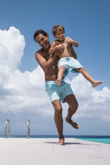 Father and son playing on shoot for Ramatuelle Beachwear
