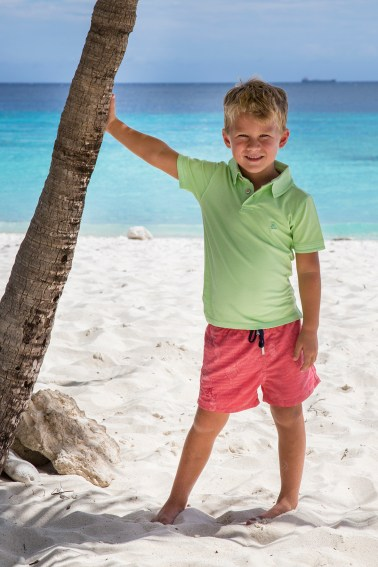 Little boy with palmtree on Curacao