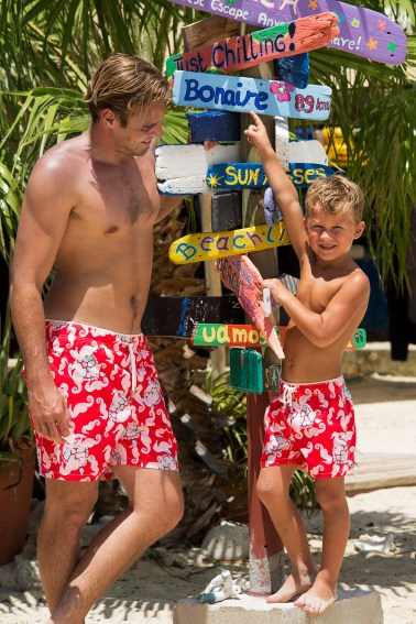 Father and son having fun on the beach for shoot Ramatuelle Beachwear