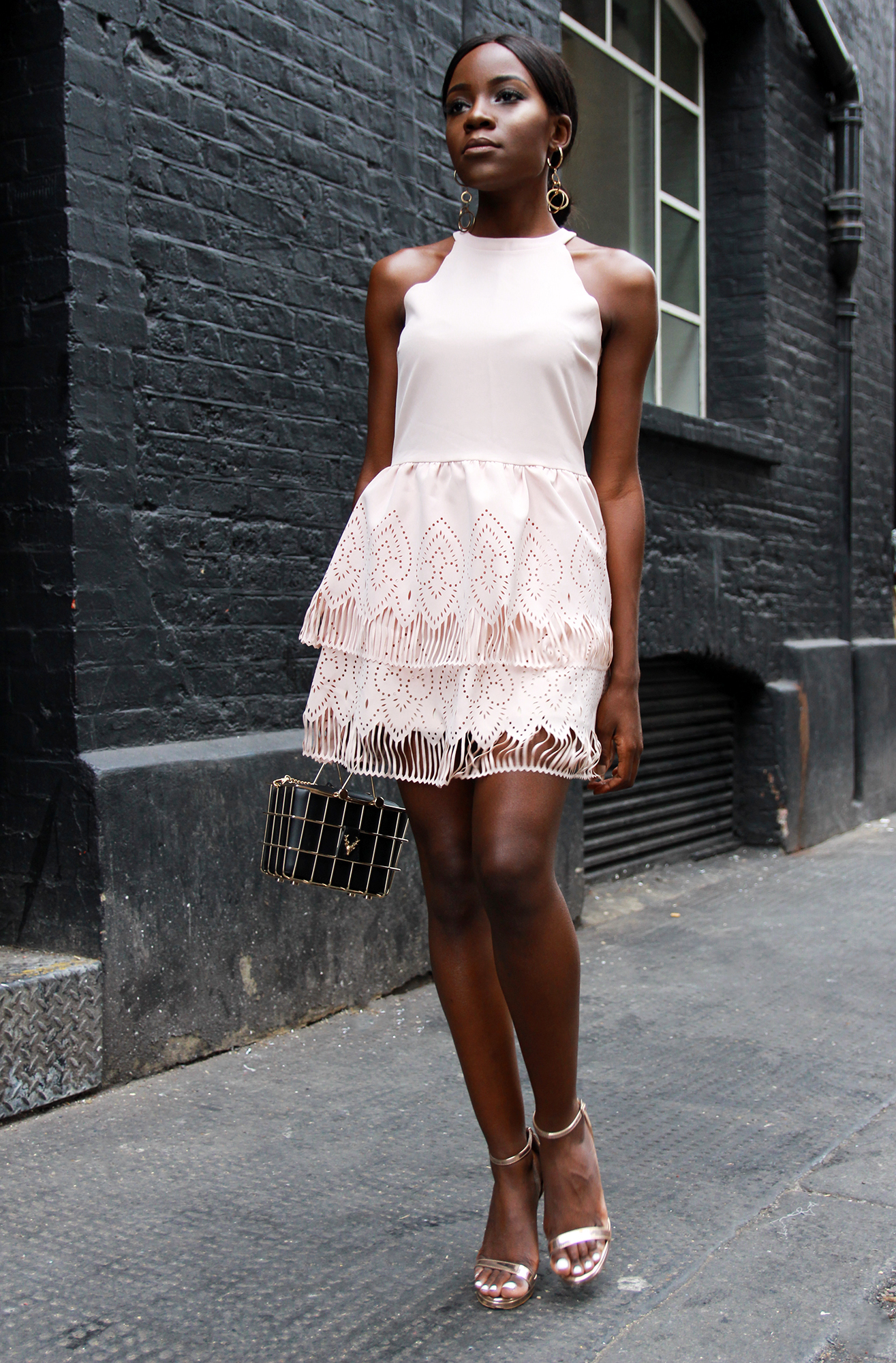perfect pink summer dress for an evening out with laser cut details