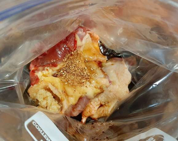 raw meat and seasonings in a freezer bag