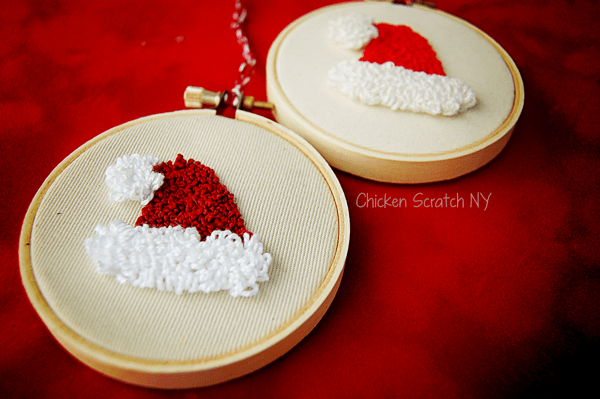 Make adorable Santa Hat Punch Needle Ornaments with this quick pattern utilizing 2 loop lengths for texture