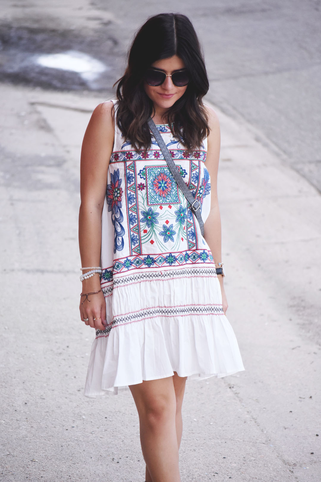 Carolina Hellal of the fashion blog Chic Talk wearing a Chicwish white embroidered dress and Nordstrom sunglasses