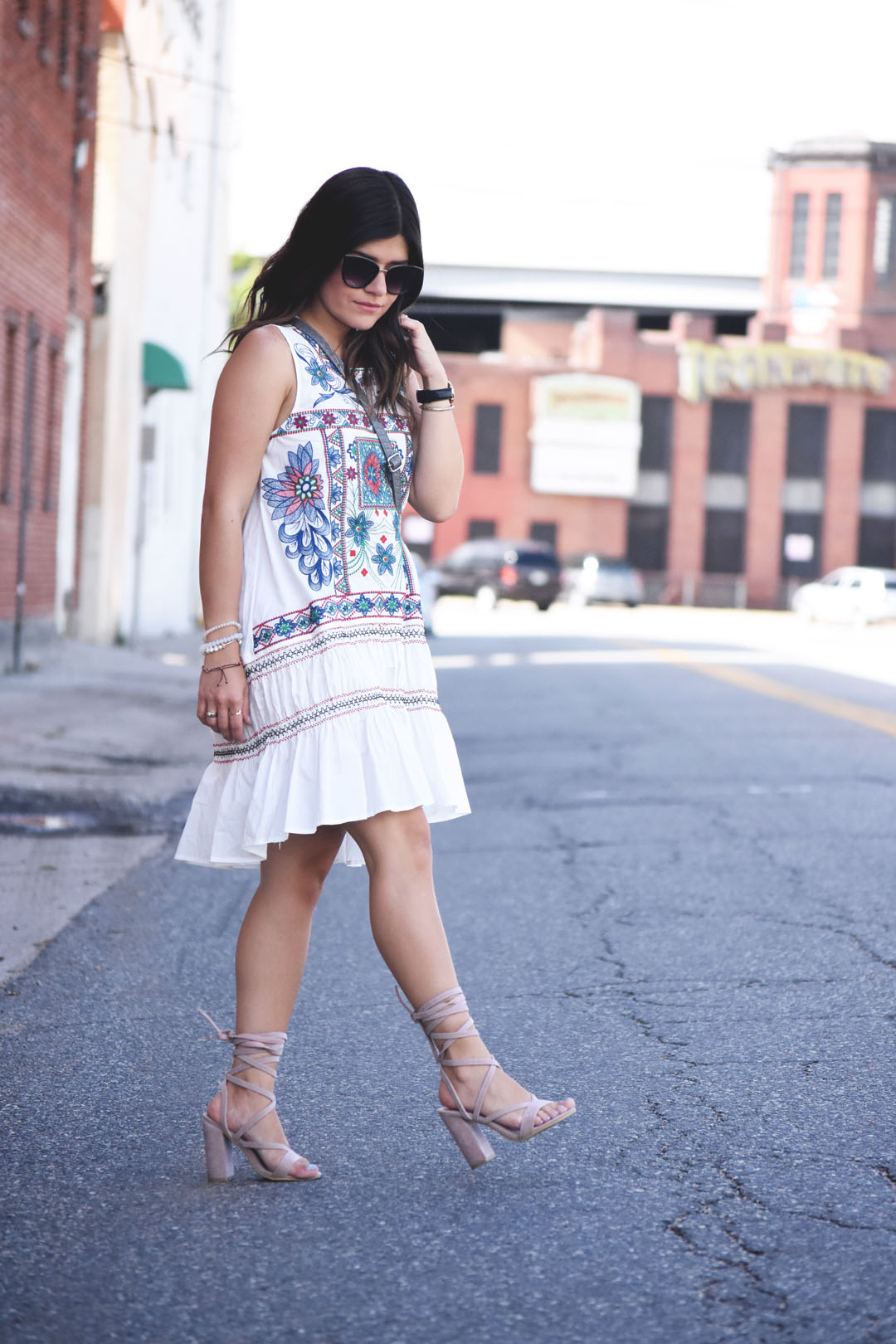 Carolina Hellal of the fashion blog Chic Talk wearing a Chicwish white dress with floral embroidery and Public Desire light pink lace up sandals