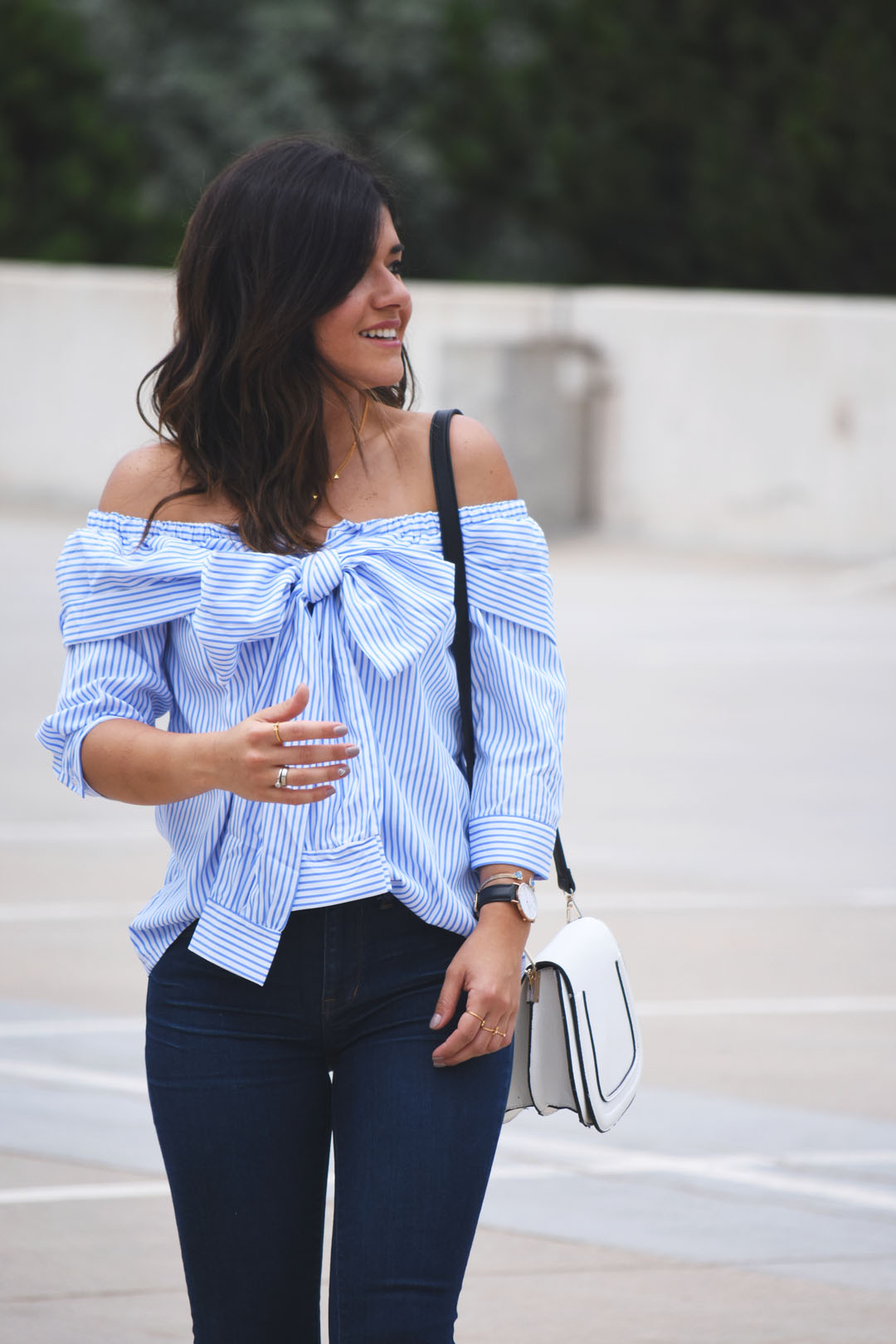 Carolina Hellal of Chic Talk wearing a SheIn off the shoulder top and Daniel Wellington black leather watch