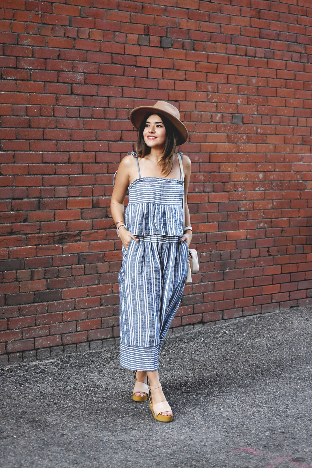 Carolina Hellal of the fashion blog Chic Talk wearing a Chicwish set of top and pants, and Sam Edelman sandals