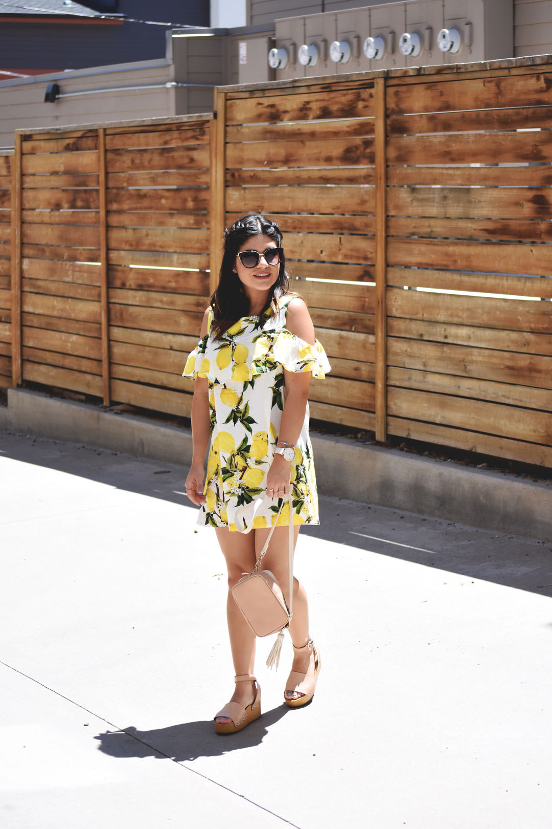 Carolina Hellal of Chic Talk wearing a lemon printed yellow summer dress via Romwe, H&M crossbody bag, and Sam Edelman beige platform sandals