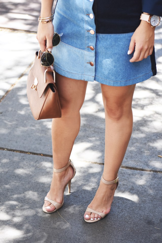 Carolina Hellal of Chic Talk wearing an H&M patch denim skirt, Rayban rounded sunglasses, Ibis Jeans button down shirt, and Steve Madden strap sandals.