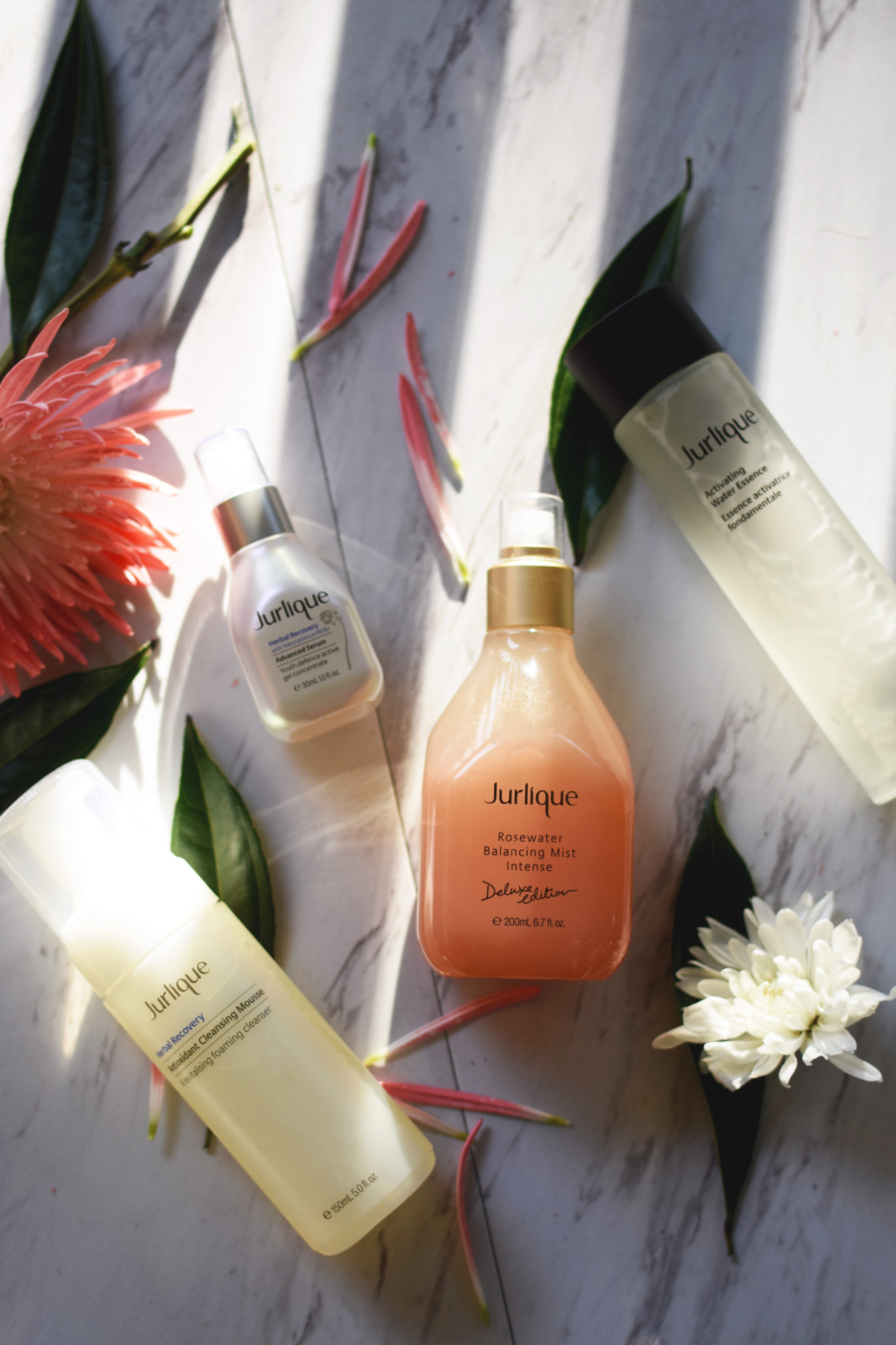 Jurlique Herbal Recovery mousse, Rosewater mist, Herbal Recovery serum, and Activating water essence.
