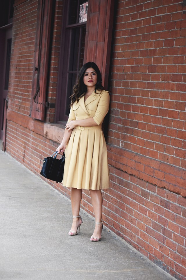 Carolina Hellal of Chic Talk wearing a Chicwish beige trench dress, black handbag and beige strap sandals